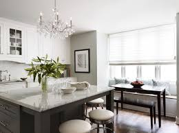 crystal chandelier for kitchen island with white granite countertops and gray wall paint color scheme