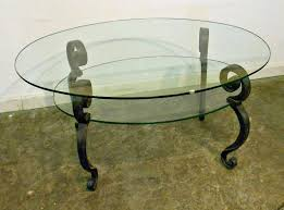 vintage glass top coffee table with black metal legs and shelves with regard to popular antique