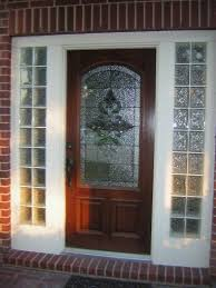 front door with glass block sidelights
