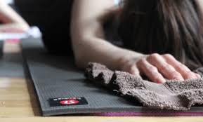 woman using manduka yoga mat