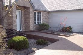 this concrete ramp blends beautifully with the aesthetics of the house and landscaping edge protection