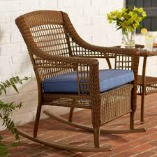 spring haven brown all weather wicker outdoor patio rocking chair with sky blue cushion