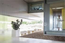 modern doctors office. Doctors Office Modern - Female Scientist In Lab Coat Standing At Window Stock