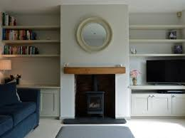 brick fireplace with shelves either side google search