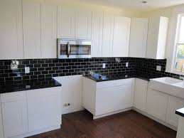 kitchens with dark cabinets and light granite cream granite countertop cream color of cooker hood stainless