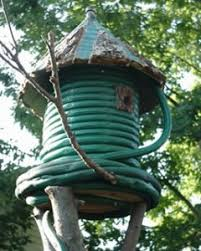 garden hose stakes. what an interesting old garden hose bird house! stakes f
