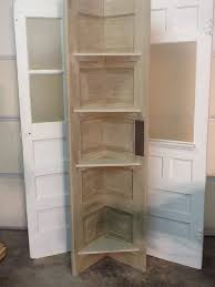 turn an old door into a corner shelf diy projects for everyone