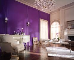 Bold purple paint for wall a pair of wall sconces lamps a classic console  table in