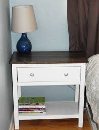 rectangular white wooden bedside table with brown wooden