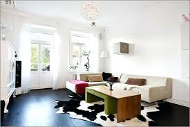 cow rug unique and fun cowhide rug living room ideas black cowhide rug with white wall paint colors rug doctor