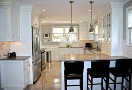 kitchen peninsula lighting. white kitchen peninsula with black seating plus hardware benson pendant lamps lighting e