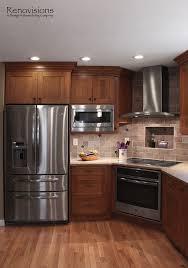 Stainless steel appliances, under cabinet lights, corner stove.