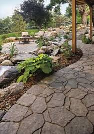 stone patio cary february full love the idea of a boulder retaining wall as a backdrop to the lower c