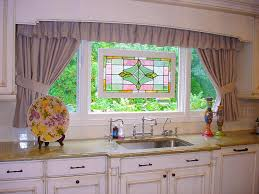 window frames with kitchen curtains plus stained glass window in over kitchen countertop with sink and faucet with plate painting