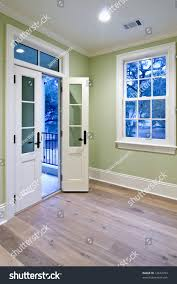 open double doors. Bedroom With Double Doors Open To Porch