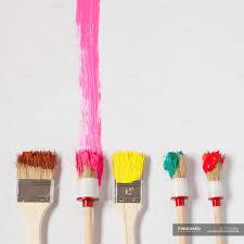 colorful stroke of brushes on white canvas stock photos