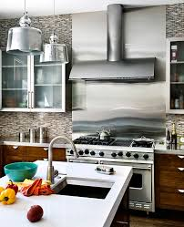 view in gallery stainless steel backsplash near the stove in a bright kitchen