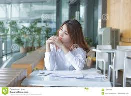 Employee Office Portrait Of Relaxed Young Asian Employee Looking At Far Away In