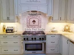 French Country White Kitchen with Fleur de lis Medallion backsplash  traditional-kitchen