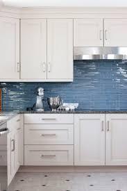 kitchen tiled splashback designs. blue/grey kitchen glass splashback tiles are a strong contrast to the all white cupboards tiled designs
