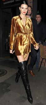 kendall jenner wearing a gold a l c velvet wrap coat dress and black leather over the