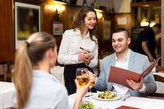restaurant waiter taking order. Brilliant Restaurant Beautiful Waitress Taking An Order From Young Lovers Couple In A  Fashionable Restaurant Stock Photos Intended Restaurant Waiter Taking Order U
