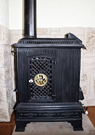 wood old metal fireplace nostalgia stove heating iron cast iron decorated oven historically hearth ornaments wood