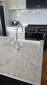caesarstone white attica 5143 in two tone cabinet design