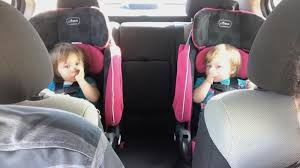 our twins sitting in their car seats but when should you replace child car seats