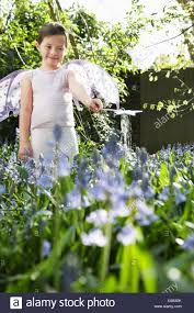 portrait of young girl 5 6 playing in garden wearing fairy costume