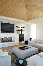 splashy sauder tv stands in living room beach style with art above tv next to wall mount
