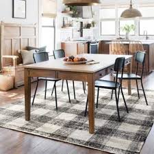 everything you need to know about choosing the correct area rug for your dining room from measuring for the right size to picking the best colors