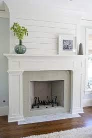 build a full mantle like this one over a brick or existing tile fireplace plank top is a great touch