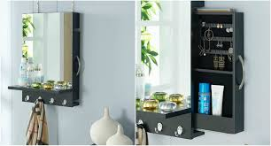 black cabinet mirror with sliding jewelry door and hanging hooks