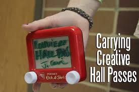 mrs louviere uses an etch a sketch for a hall pass