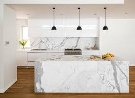 view in gallery dark pendant lights offer visual contrast in the white kitchen filled with marble goodness photo