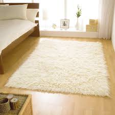 fluffy rugs with white fur rug and wooden floor also small windows plus white blanket mattress for placed bedroom design