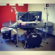 and now for something completely diffe stick the kick drum computer case under this drum kit desk you can add a cymbal to one of the stand and use