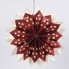 a star made from glittery paper bags fitted with concealed battery powered led lights