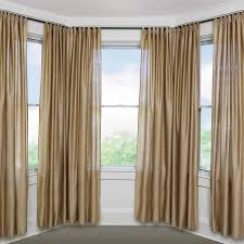 image of small bay window curtain rods
