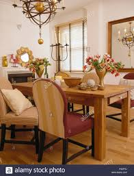 Light Wood Upholstered Dining Chairs Gimbal Style Light Above Simple Pine Table With Upholstered
