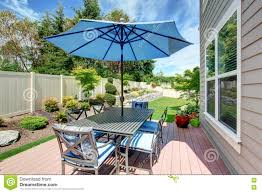 Patio Landscape Design Pictures House With Backyard Patio And Landscape Design Stock Image