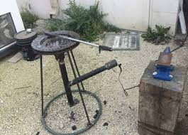how to make a forge. here is a forge made by grizzly man. he calls it the double barrel forge. and literally right! out of two barrels. how to make