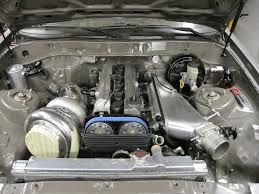 post up your pics of you custom intake manifolds just need to figure out how to run my intercooler piping now p