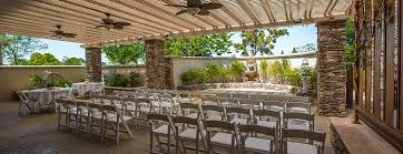 the secret garden adjacent to the grand ballroom is a semi enclosed outdoor 2125 square foot patio with a pergola style roof top