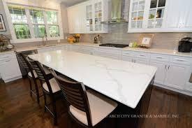 kitchen countertops with calcatta classique q quartz white and espresso cabinets combination