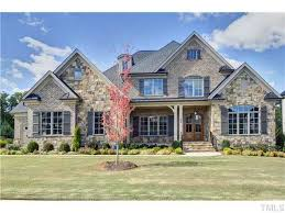 All brick & stone exterior with double door entry at front porch! Home has a