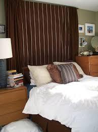 Add curtains for headboard.