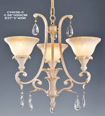 3 light pink with rust effect chandeliers