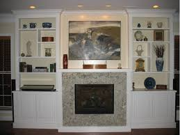marble fireplace with white built in cabinetry